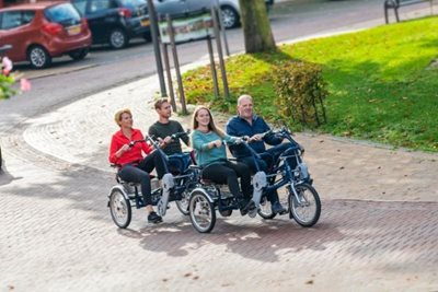 Side-by-side tandems to cycle with a disability