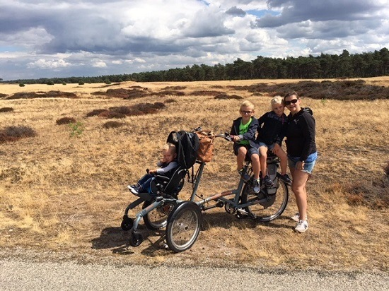 User experience wheelchair bike OPair by Van Raam family Klomp in National Park the Hoge Veluwe