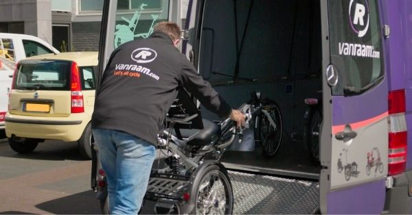 Van Raam technical advisor in the field - loading unloading bikes in Van Raam bus