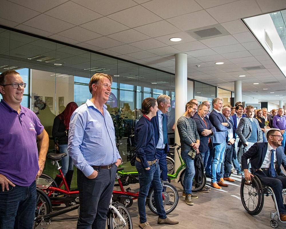 Guests and employees at festive opening new bicycle factory Van Raam