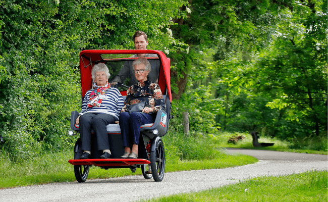 Van Raam rickshaw transport bike for Cycling Without Age - cycling with the canopy