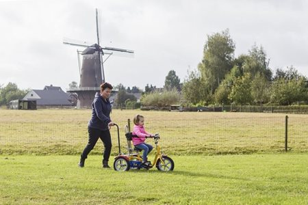 Van Raam tricycle for children making a test ride