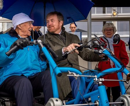 Dutch king cycles on Van Raam side-by-side tandem Fun2Go