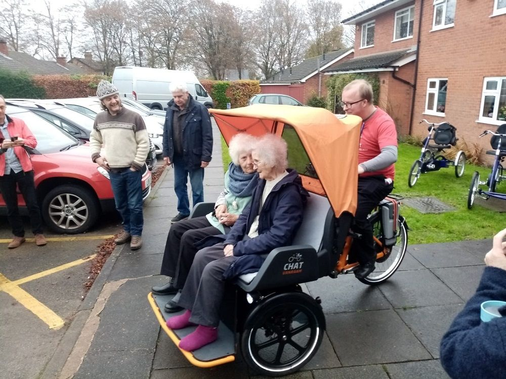 Residents of the nursing home Rowheat in England on Van Raam rickshaw bike Chat