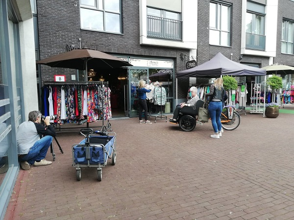 Rickshaw cargo bike Chat photo shoot Van Raam shopping street